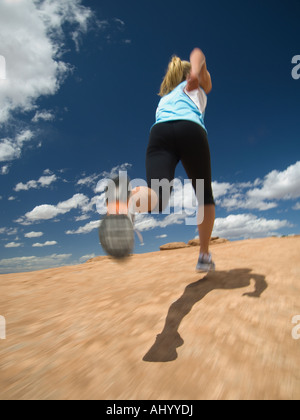 Low angle view of woman jogging - Stock Photo