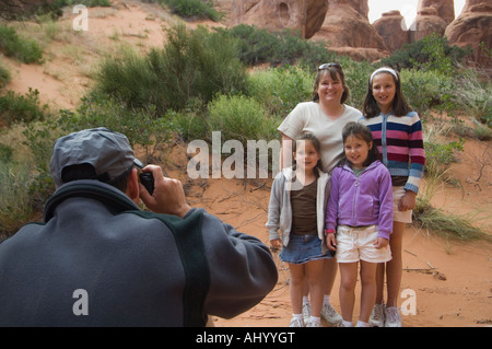 Father taking photograph of family - Stock Photo