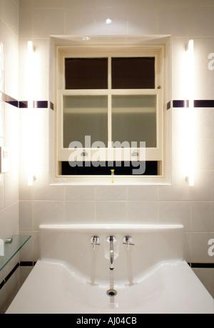 Sash window in restored bathroom of contemporary interior London England - Stock Photo