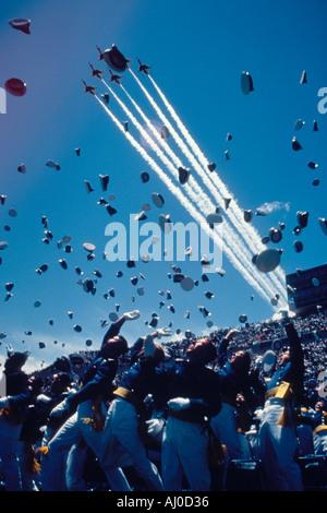 U Air Force Academy graduates toss their cadet caps into the air as the USAF Thunderbirds fly overhead Colorado - Stock Photo