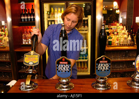 Bar person pulling pints at The Gatekeeper pub in Cardiff South Wales UK - Stock Photo