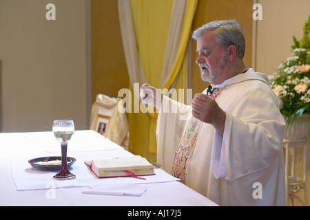 Catholic Priest Administers Wedding Vows And Prayers At St Thomas Church In Ojai California