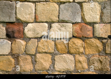 Old stone wall from the boundary of an 18th century castle - Stock Photo