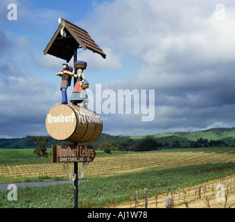 Sign made with statuettes of a couple carrying grapes standing on a barrel in the Barossa Valley near Adelaide South - Stock Photo