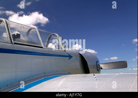 Old Russian fighter plane against a blue cloudy sky - Stock Photo