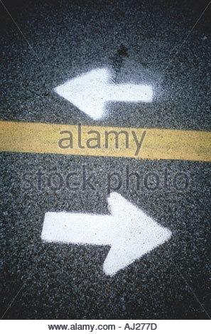 directional arrows on asphalt - Stock Photo