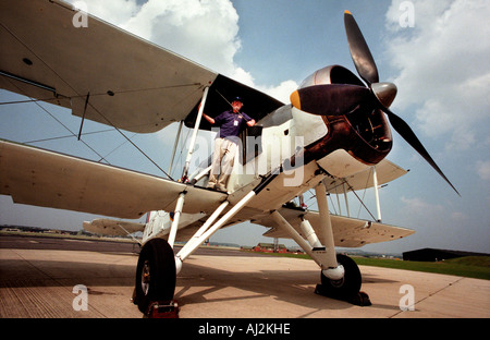 Former pilot John Tupper stands on the wing of his Swordfish biplane - Stock Photo
