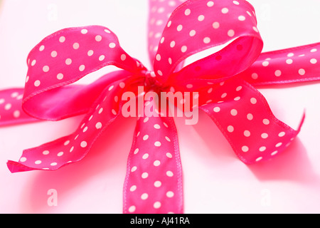Pink Polk a Dot Bow on Gift - Stock Photo