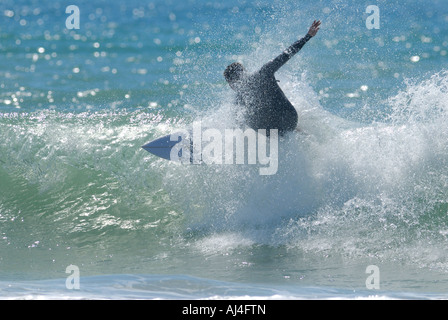 Surfer carving off the lip of  wave - Stock Photo