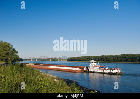 Towboat and Barge on the Ohio River Waiting to Enter the McAlpine Locks New Albany Indiana - Stock Photo