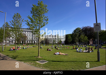 people enjoying the sunshine on the green Eyre Square in Galway city county Galway Republic of Ireland known as - Stock Photo