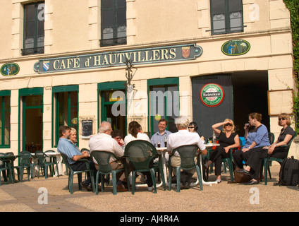 A group of people sitting outside in the sunshine at the Cafe d'Hautvillers, the village of Hautvillers in Vallee - Stock Photo