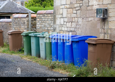 Green blue and brown plastic wheelie bins used for recycling household waste in the South Ayrshire town of Troon - Stock Photo