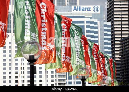 Christmas decoration banners with Allianz logo on Pyrmont Bridge in Darling Harbour Sydney New South Wales NSW Australia - Stock Photo