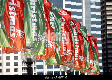 Christmas decoration banners on Pyrmont Bridge in Darling Harbour Sydney New South Wales NSW Australia - Stock Photo