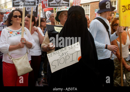 A woman in western dress and a muslim woman in Islamic dress protest the Lebanon war. Copyright Terence Bunch - Stock Photo