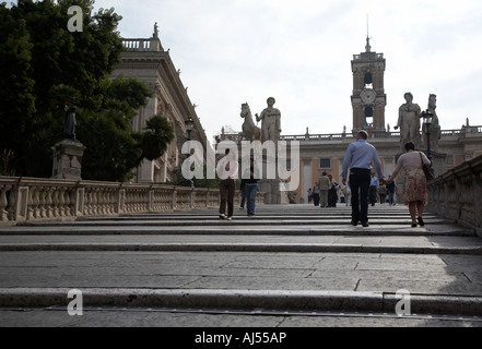 tourists walk on the Cordonata steps Michelangelo designed steps leading up to the Campidoglio Rome Lazio Italy - Stock Photo