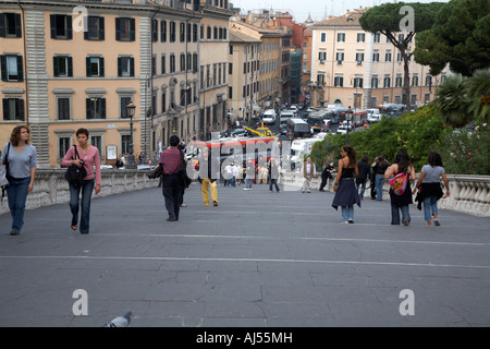 tourists walk on the Cordonata steps Michelangelo designed teps leading up to the Campidoglio looking down - Stock Photo