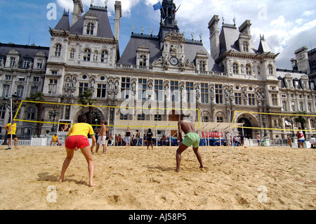 People playing beach volleyball on an artificial field set up in front of City Hall during the Paris Plage event, - Stock Photo