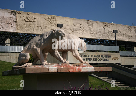 statues of sabre tooth tigers at entrance to George C Page Museum Tar Pit Discoveries Los Angeles  October 2007 - Stock Photo