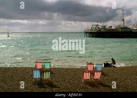 Colorful deck chairs on Brighton beach - Stock Photo