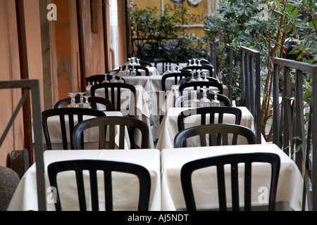 empty tables laid out waiting for customers in trastevere Rome Lazio Italy - Stock Photo
