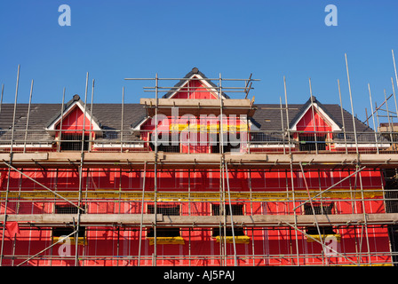 New environmental friendly residential buildings showing the pink cavity insulation material used for the construction.