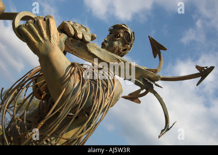 Abstract steel sculpture Hombres de Mar of fisherman with anchor in memory of those lost at sea Laredo Spain - Stock Photo