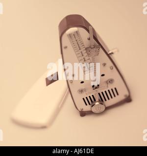 Bakelite metronome on plain background - Stock Photo