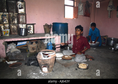 Young boys working in kitchen, Khavda Village, Kutch district, Gujarat, India - Stock Photo