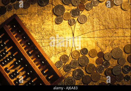 Abacus coins and old world map - Stock Photo