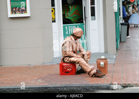 Street performer on Bourbon Street New Orleans LA - Stock Photo