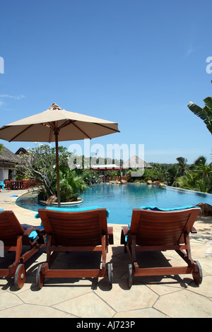 Potrait View of a Swimming pool and huts in a resort in Kerala, India. - Stock Photo