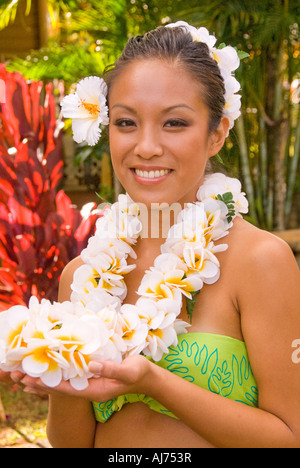 Hawaii Kauai Portrait of attractive Hawaiian female hula dancer in native dress wearing a 'lei' of colorful garland - Stock Photo