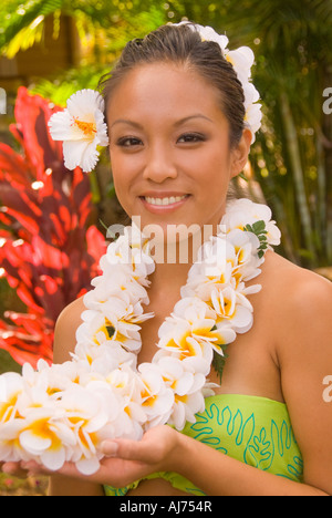 Hawaii Kauai Portrait of attractive Hawaiian female hula dancer in native dress wearing a colorful 'lei' of garland - Stock Photo