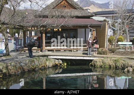 A Pond and a Traditional House Oshino Hakkai Yamanashi Japan - Stock Photo