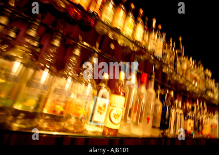 Bar back interior with vodka bottles on cocktail - Stock Photo