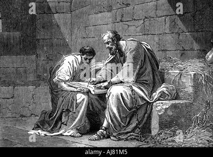 St Paul the Apostle in prison, writing his epistle to the Ephesians, 1st century AD (19th century). Artist: Unknown - Stock Photo
