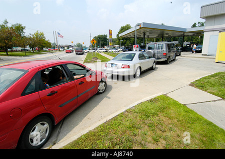 Long Lines Form At Gas Station because of high prices and shortages of gasoline - Stock Photo