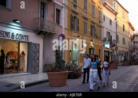 Group of young people walking over street Corso Umberto I Olbia Gallura Sardinia Italy - Stock Photo