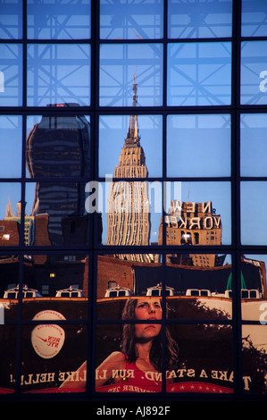 Empire State Building along with portion of NYC skyline reflected in the glass surface of the Javits Convention - Stock Photo