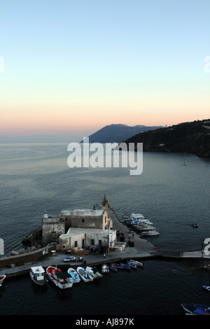 Sunset in the harbour of Marina Corta at Lipari in the Aeolian Islands Sicily Italy - Stock Photo