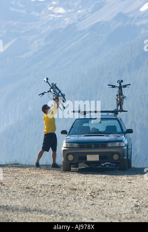 Young man mountain biking in Mount Rainier National Park, WA - Stock Photo
