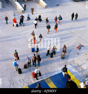 View looking down onto quay of  passengers with luggage leaving a Greek Island ferry on Santorini Greece EU  KATHY - Stock Photo