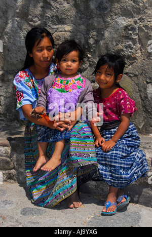 Indigenous family in traditional Mayan dress - Stock Photo