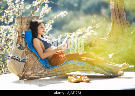 Woman Relaxing Outdoors - Stock Photo