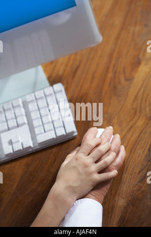 Child's and Adult's Hand Using Computer Mouse - Stock Photo