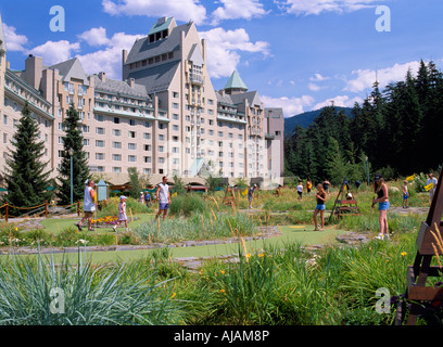 People playing Mini Golf at Fairmont Chateau Whistler, Whistler, BC, British Columbia, Canada - Stock Photo