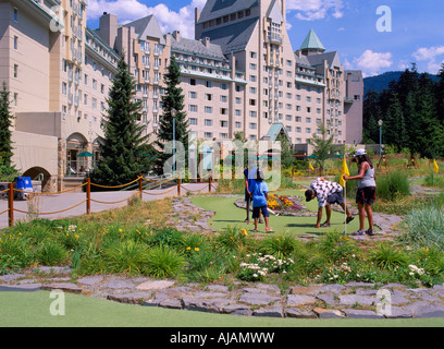 Family playing Mini Golf at Fairmont Chateau Whistler, Whistler, BC, British Columbia, Canada - Stock Photo