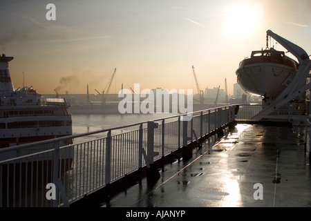 Leaving Portsmouth in the early morning  - Stock Photo